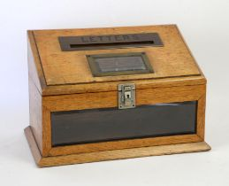 Early 20th century oak letter box, the sloping top with brass framed posting slot worded 'Letters',