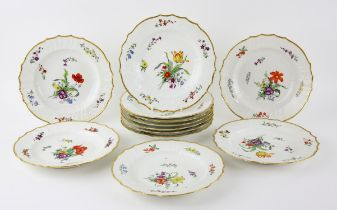 Twelve Royal Copenhagen porcelain plates, hand-painted with varying blossoming flowers and with
