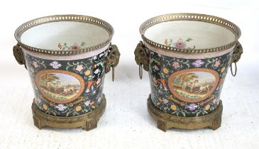 Pair of porcelain and gilt metal mounted jardinières with gilt metal rams head handles and painted
