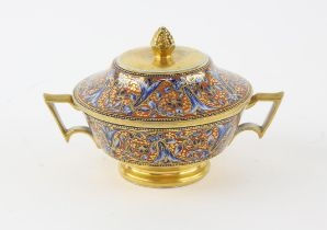 Twin handled porcelain pot and cover, decorated with flowers on an orange ground, H12.5 x W19cm