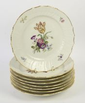 Eight Royal Copenhagen plates painted with blossoming flowers, basket weave borders,