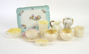 Nine pieces of Belleek porcelain and a Limoges tray and a porcelain vase, to include a Belleek cup