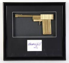 James Bond The Man With The Golden Gun (1974) - A replica golden gun, mounted inside a framed
