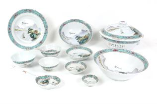 Modern Chinese porcelain part dinner service, decorated with houses in mountainous landscape within
