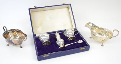 Boxed silver cruet set, comprising a mustard pot with lid and blue glass liner, a salt pot with