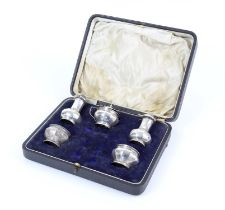 Cased silver five piece cruet set consisting of one mustard, two pepper and two salts,