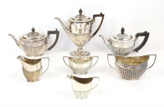 Four piece silver plated tea set and a three piece silver plated tea set both by Goldsmith and