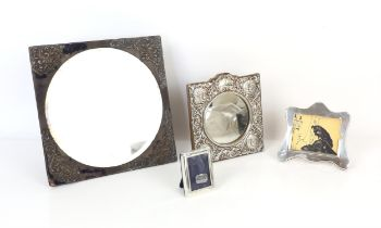 Boxed silver photo frame, a large silver framed mirror, another silver photo frame and a plated