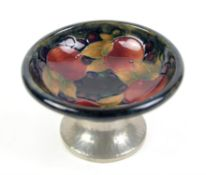 William Moorcroft for Liberty & Co, small pedestal dish, the shallow bowl decorated in the