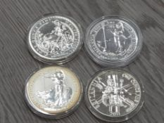 4 UK SILVER ONE OUNCE BRITANNIAS WITH DATES COMPRISING 2002 2005 2011 2014