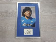 FRAMED AND MOUNTED PHOTOGRAPH OF DIEGO MARADONA WITH SIGNATURE BELOW