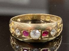 A 15CT YELLOW GOLD RUBY AND WHITE STONE BAND COMPRISING OF TWO ROUND CUT RUBIES COMPLETE WITH
