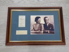 BRITISH ROYALTY EDWARD AND WALLIS SIMPSON FRAMED PHOTOGRAPH MOUNTED UP ALONGSIDE AN EXAMPLE OF HIS