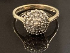 9CT YELLOW GOLD AND DIAMOND CLUSTER RING COMPRISING OF THREE ROWS OF SMALL ROUND CUT DIAMONDS IN A