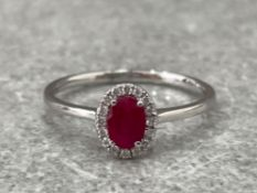 18CT WHITE GOLD RUBY AND DIAMOND RING .60CTS SIZE O 1.7G
