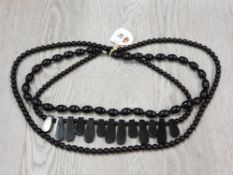 "3 FRENCH JET BEAD NECKLACES 1 OVER THE HEAD 32"" 1 WITH SAME SIZED OVAL BEADS 25"" AND 1 WITH FRONT"