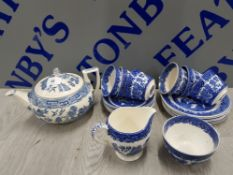 21 PIECES OF BLUE AND WHITE WILLOW PATTERN INCLUDES TEA POT, MILK JUG, CUPS, SUGAR BOWL AND PLATES