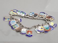 SILVER BRACELET WITH ASSORTED SILVER AND ENAMEL SHIELD CHARMS 41G GROSS