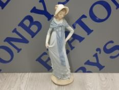NAO BY LLADRO FIGURE OF A LADY WEARING LONG BLUE DRESS AND BONNET SAS