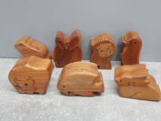 7 hardwood secret compartment boxes including bull lion rabbit hate frog fish and penguin