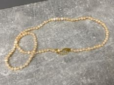 Peach freshwater Pearl necklet and bracelet 2 piece set