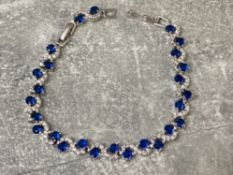 Silver blue and white CZ set line bracelet, 12.6g
