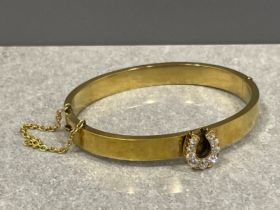 Gold (high carat) Victorian plain bangle with central 9 diamond set horseshoe motif and safety chain