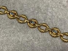 9ct gold blue topaz oval link bracelet 19cms 17.34g