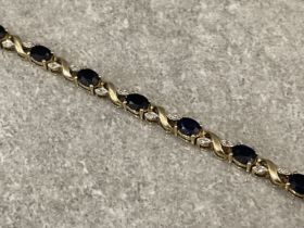 9ct gold 13 sapphire and 26 diamond crossover link bracelet 17cms 6.98g