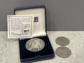 Cased Dutch coin and 2 crowns
