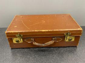 Vintage brown leather suitcase