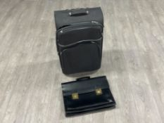 Travel case and black leather briefcase