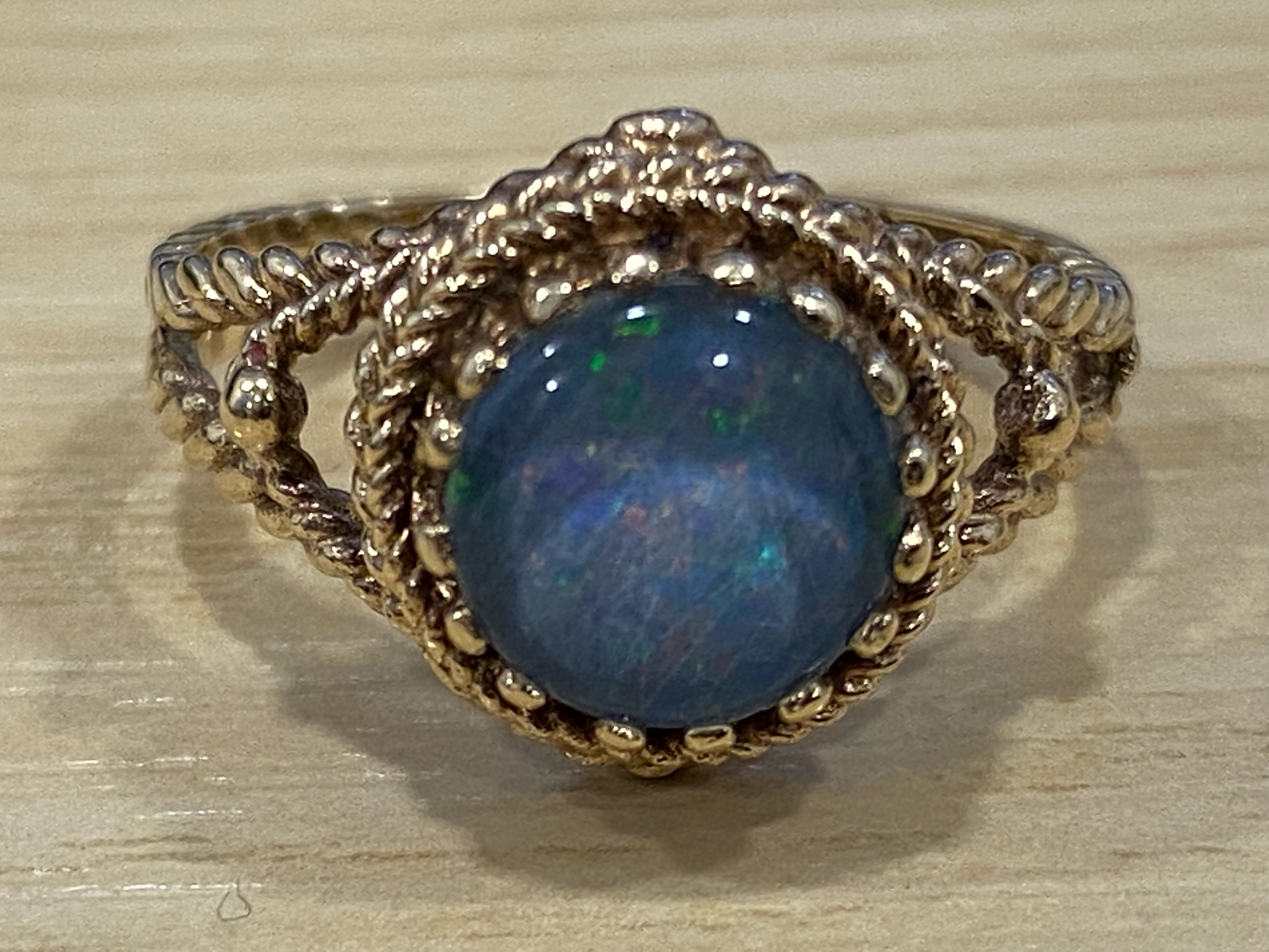 A 9ct yellow gold and opal ring, in claw setting, 3.2g gross, size L.