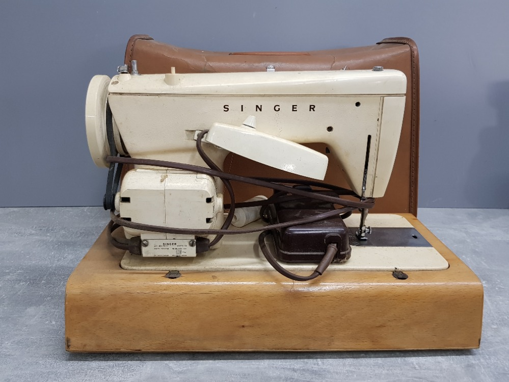 Vintage Singer sewing machine with carry case