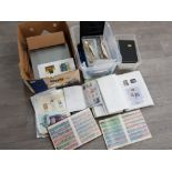 2 boxes of uncirculated stamps from around the world some in albums, also includes religious themed