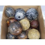 Various decorative balls and carpet bowles in wood pottery etc.