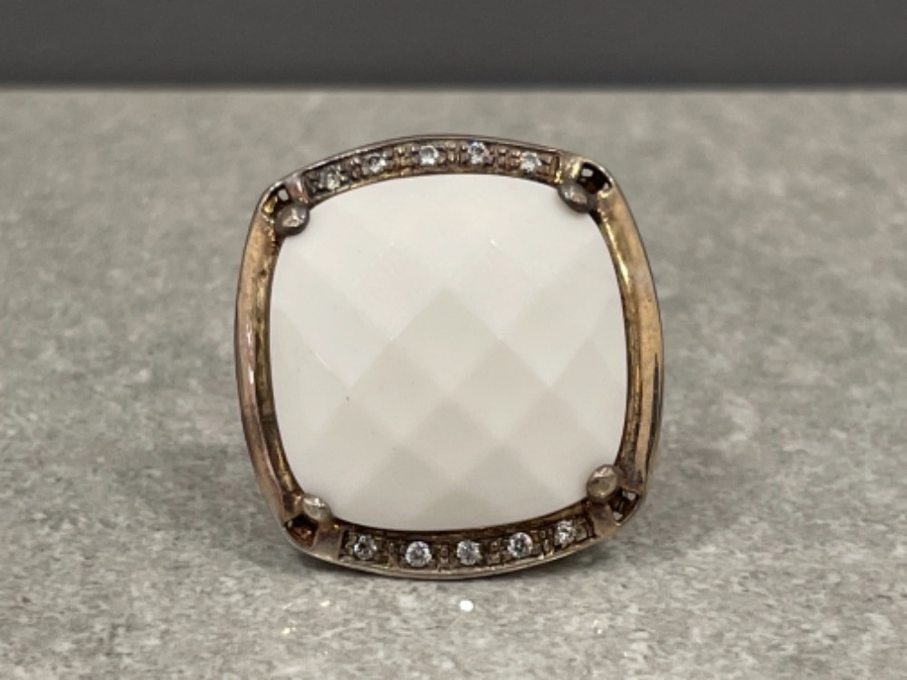 Ladies silver large white stone ring. Set with CZs