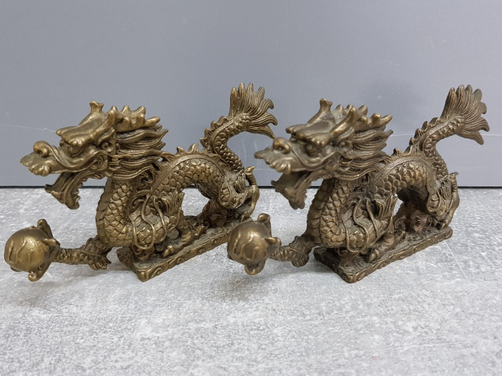 Pair of brass Chinese foo dragons, 13x7cm