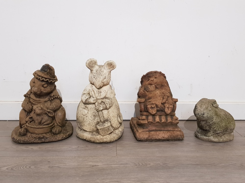 Four composite stone garden ornaments imcluding beatrix potter characters by Hilltop products,