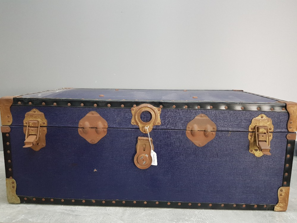 An Overpond travelling trunk with metal mounts 91cm wide.