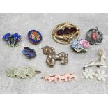 1950s plastic brooches and hair slides together with an italian micro mosaic brooch.