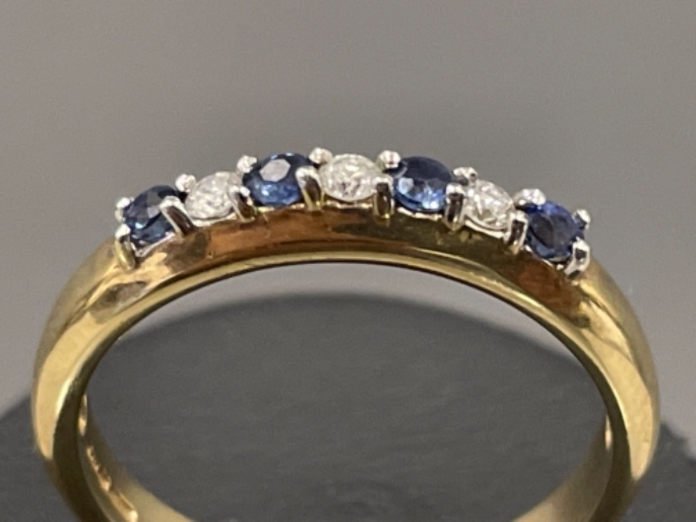 Ladies 9ct gold Sapphire and Diamond ring. Featuring 7 stones 4 sapphires and 3 round brilliant - Image 3 of 3