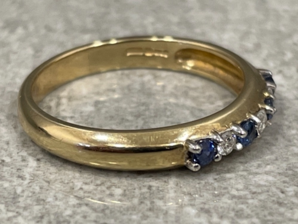 Ladies 9ct gold Sapphire and Diamond ring. Featuring 7 stones 4 sapphires and 3 round brilliant - Image 2 of 3