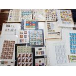 Quantity of mixed stamps, albums and full sheets of uncirculated stamps