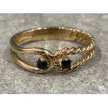 Ladies 9ct gold 2 stone Sapphire ring with a twist design. 2.7g size O