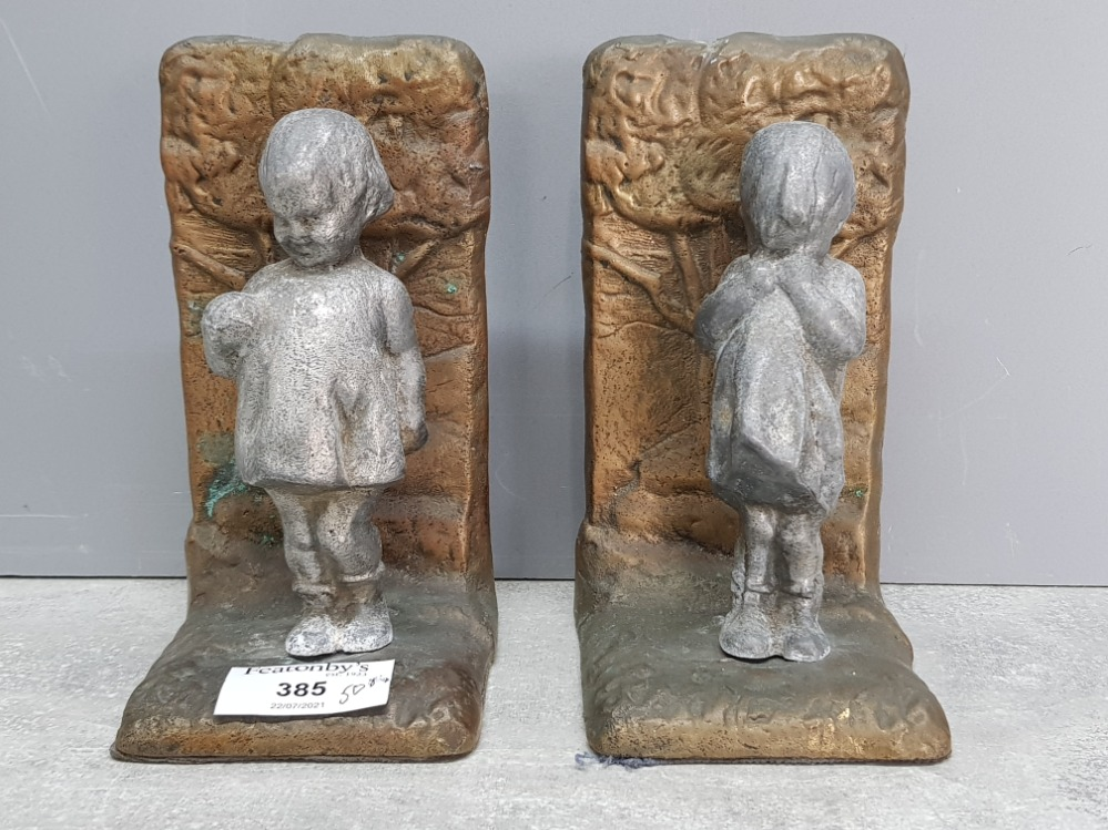 A pair of cast iron and aluminium bookends in the form of two little girls 15cm high. - Image 2 of 3