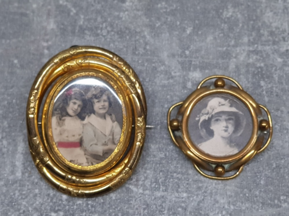 Two Victorian brooches, one gilt metal and the other brass, largest 6.5cm high.