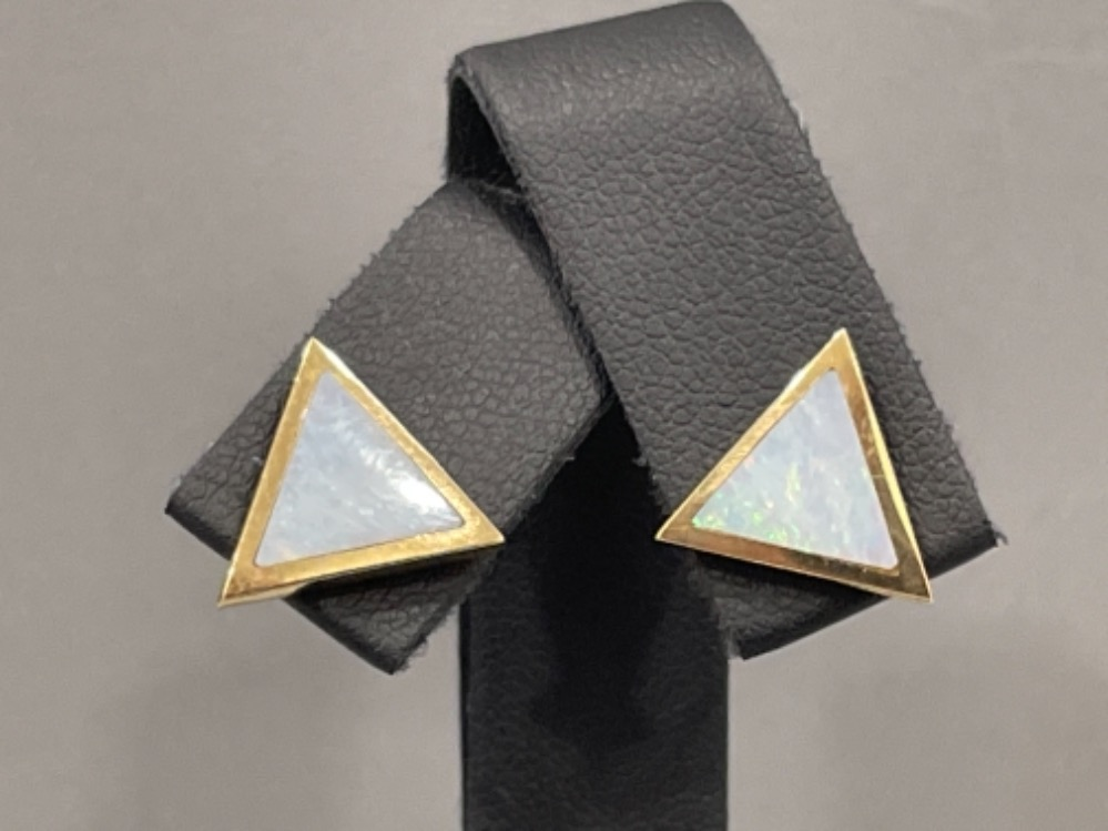 Ladies 9ct gold triangle shaped Opal stud earrings.