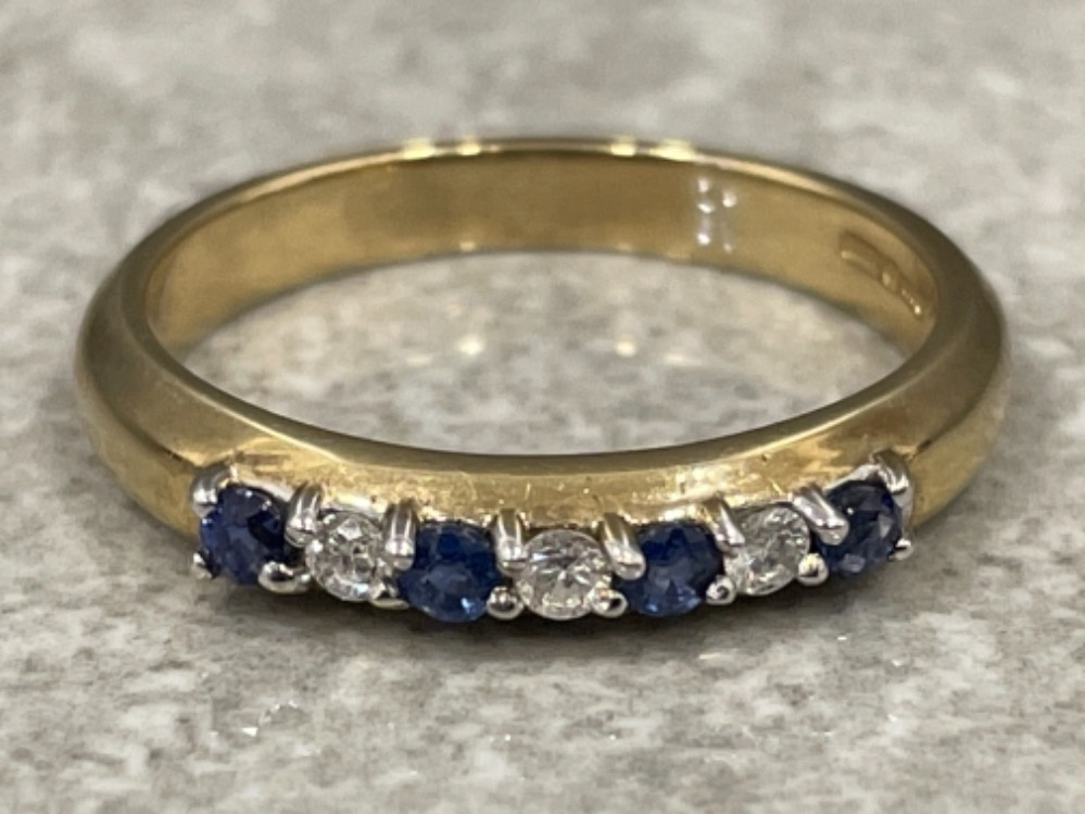 Ladies 9ct gold Sapphire and Diamond ring. Featuring 7 stones 4 sapphires and 3 round brilliant