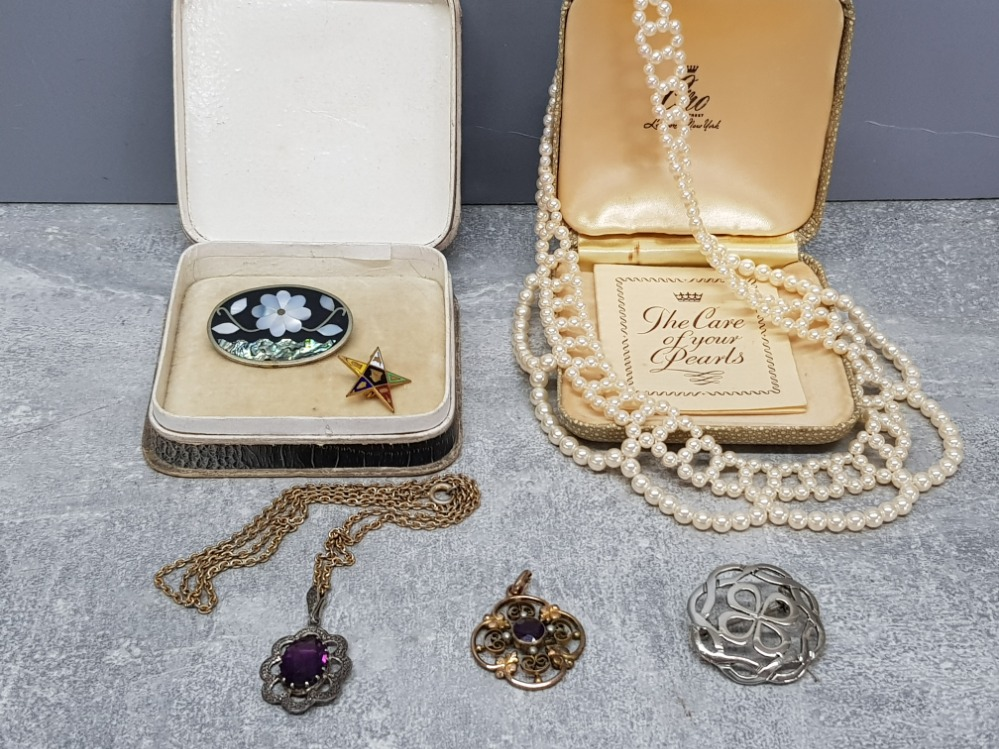 A gold plated edwardian pendant with purple paste stone and seed pearls, a marcasite and paste